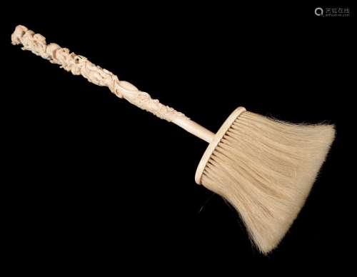 ϒ A Continental, probably German or Austrian, carved ivory and horse hair domestic brush