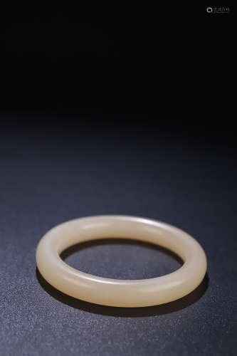 AN OLD HETIAN JADE BANGLE