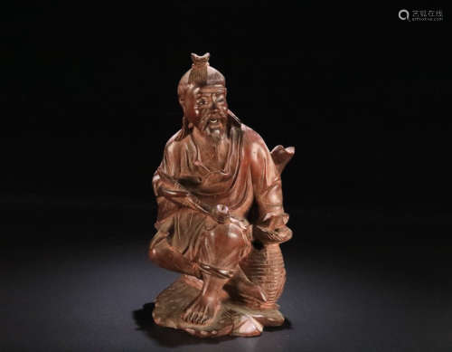 A HUANGYANG WOOD CHARACTER SHAPED ORNAMENT
