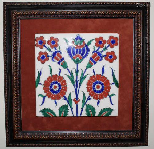 Framed Iznik pottery tile.
