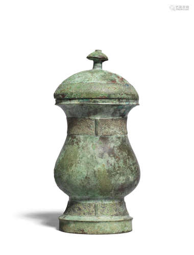 Shang Dynasty An archaic bronze wine vessel and cover, zhi