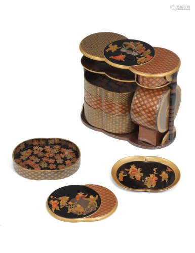 Edo period (1615-1868), early/mid-19th century A Gold-lacquer portable sage-jubako (picnic box)