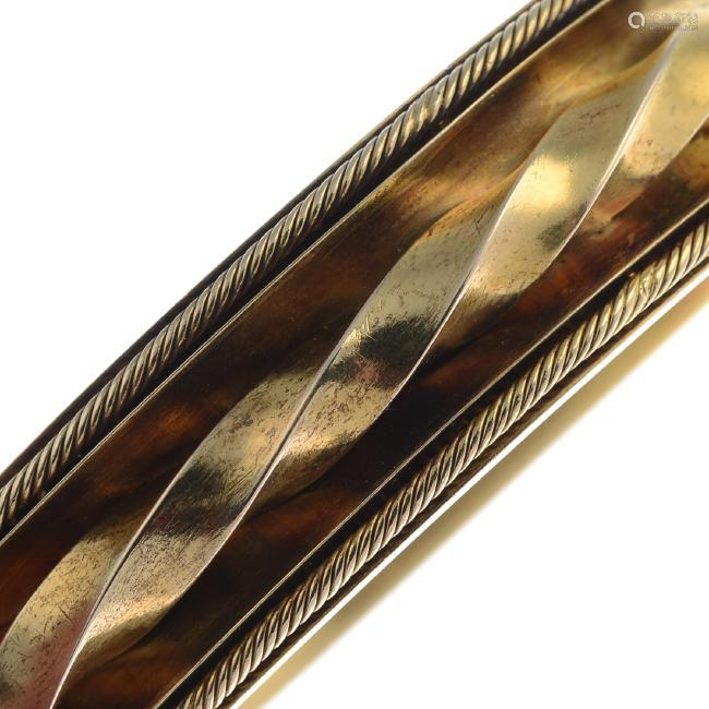 A late Victorian 18ct gold hinged bangle. The concave