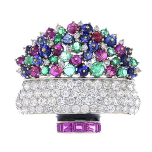 A diamond and gem-set floral brooch. The pave-set