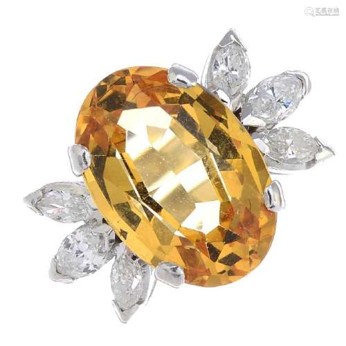 A topaz and diamond cocktail ring. The oval-shape
