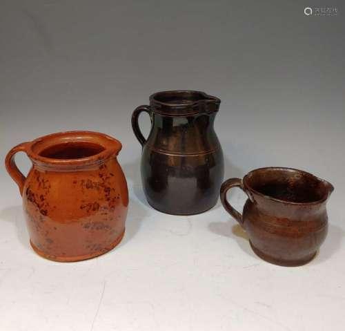 (3) Glazed 19th Century Redware Pitchers