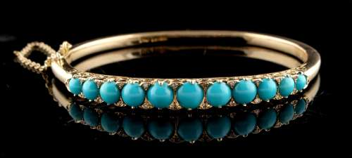 A Victorian 14ct yellow gold turquoise & diamond hinged bangle, of good grade, with safety chain,