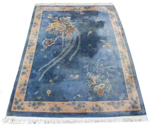 Property of a gentleman - a Chinese hand knotted wool carpet, late 20th century, with blue ground,