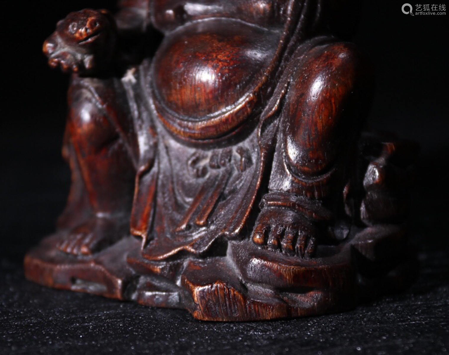 A CHENXIANG WOOD CARVED CHILD SHAPED PENDANT