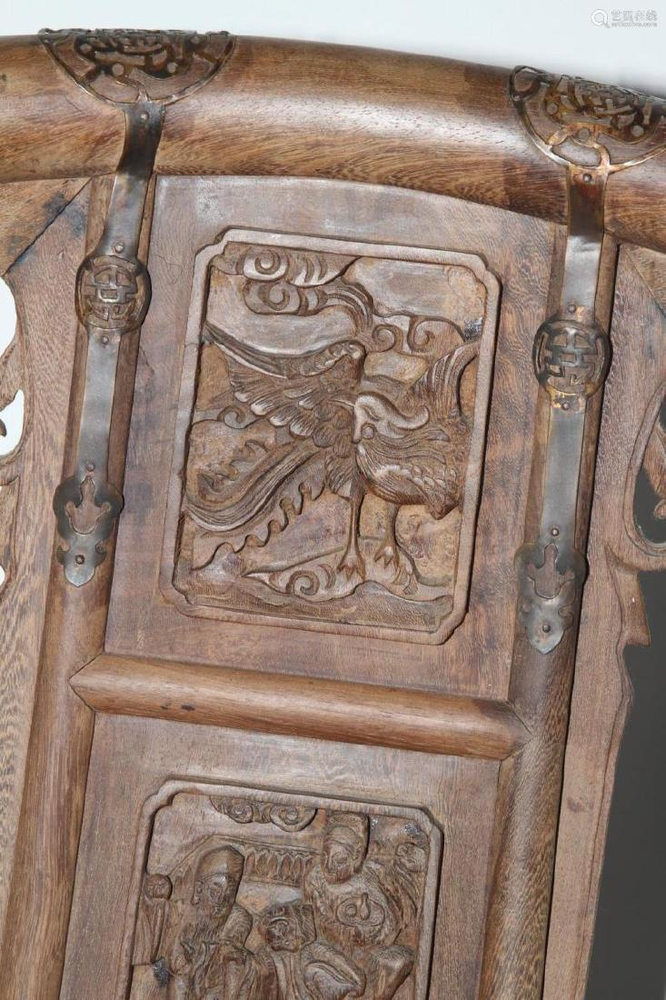 Pair of Carved Saddleback Chinese Chairs
