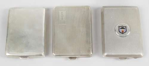 Three silver matches cases,