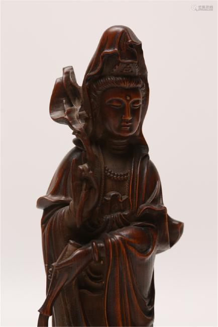 A CARVED HUANGYANGMU GUANYIN AND BOY.ANTIQUE