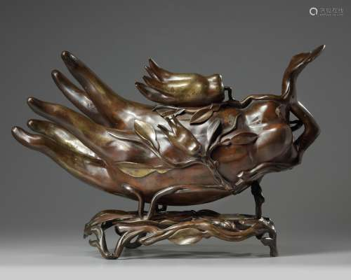 A large Chinese bronze finger citron censer and stand