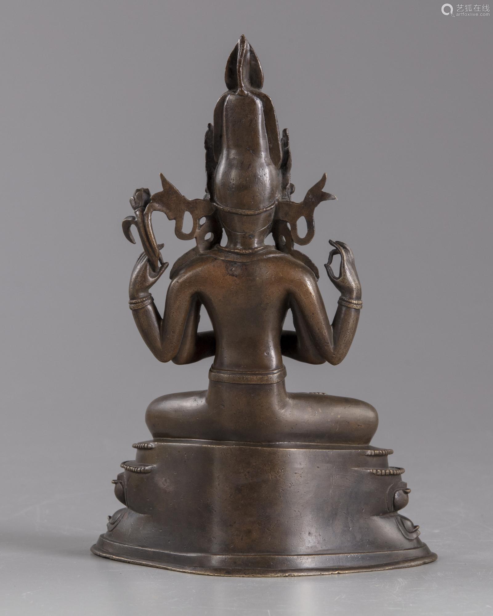 A Sino-tibetan four armed bronze figure