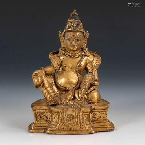 Vergoldeter Buddha.Wohl Tibet, Bronze, vergoldet mit Türkisen, Boden geschlossen. H 15 cm. Auf einem