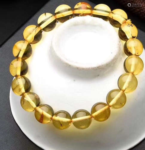 AN AMBE RINSECT  BEADS BRACELET