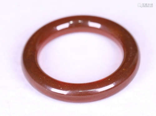 A QING DYNASTY STYLE  AMBER BANGLE