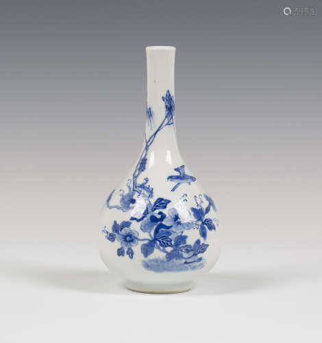 A Chinese blue and white export porcelain bottle vase, Qing dynasty, painted with a bird flying