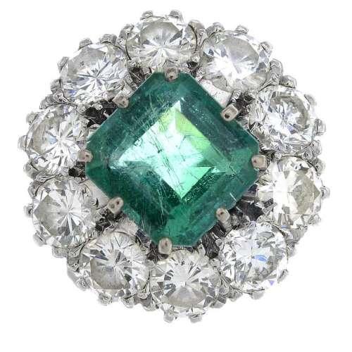 A mid 20th century platinum emerald and diamond cluster