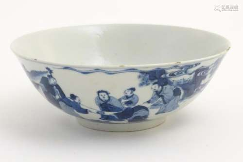 A 19thC Chinese blue and white bowl depicting figures