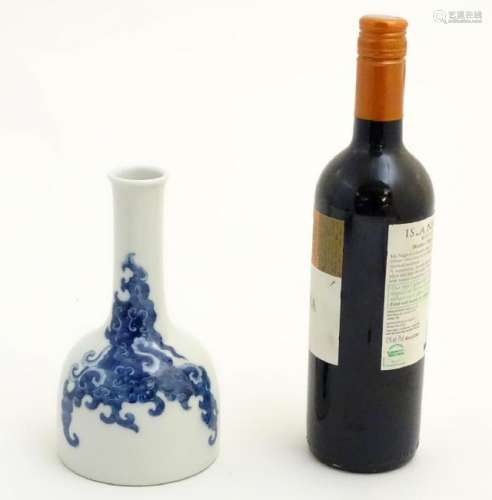 A Chinese blue and white bottle vase with a stylised,
