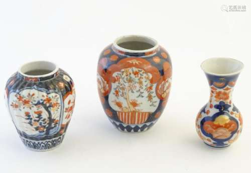 Three Imari vases decorated with panelled floral