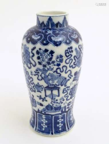 A Chinese blue and white vase decorated with emblems of
