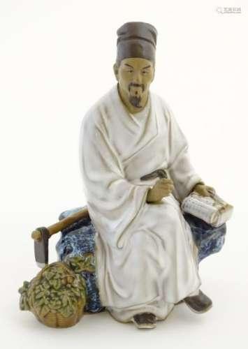 A Chinese partially glazed ceramic mudman figurine