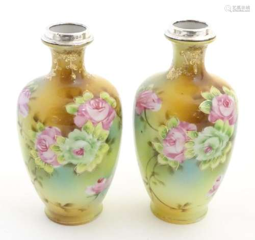 A pair of small Japanese baluster vases with hand
