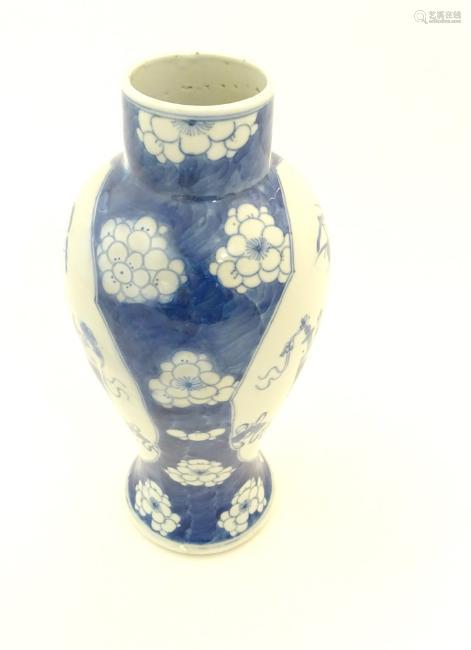 A Chinese, blue and white baluster vase decorated with