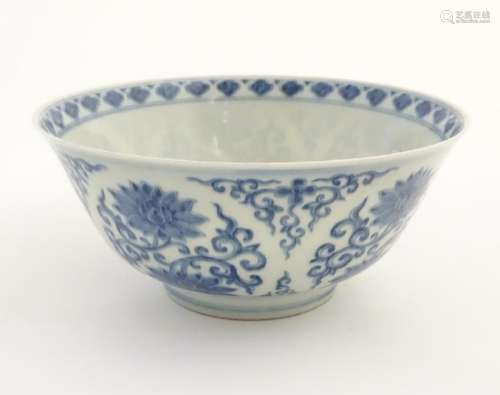 A Chinese blue and white bowl decorated with flowers