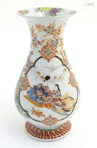 A Japanese baluster vase with a flared foot and rim,