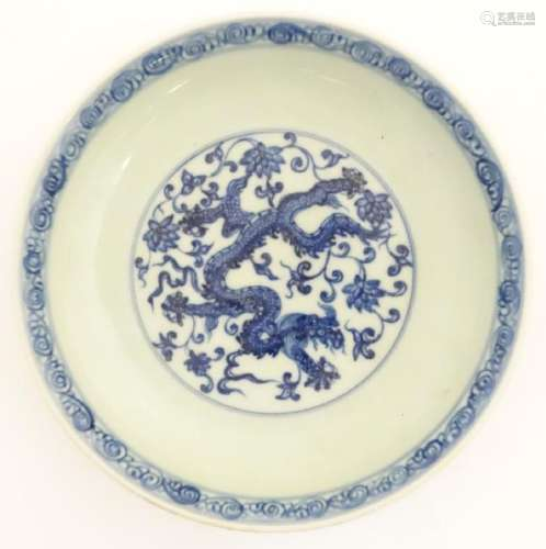A Chinese blue and white dish decorated with dragons,