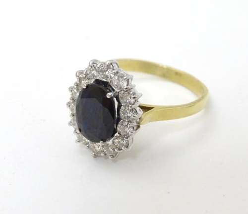 A vintage 18ct gold ring set with central sapphire