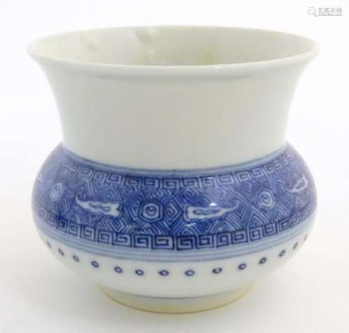 A Chinese pot/vase of squat form, with a round body and