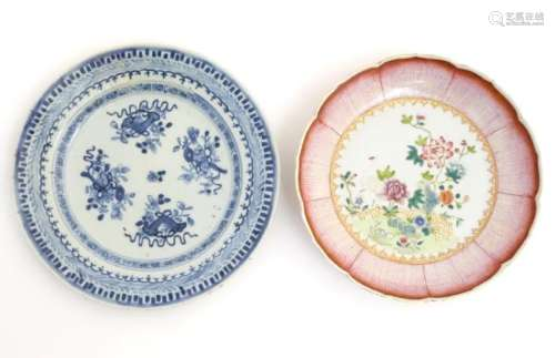 An 18thC Chinese blue and white plate decorated with