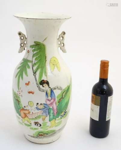 A 20thC Chinese twin handled baluster vase, decorated