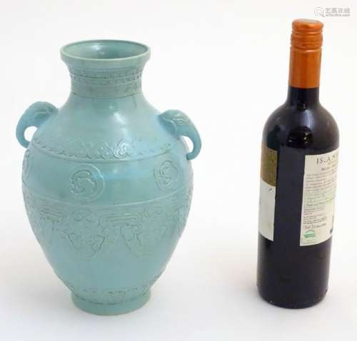 A Chinese celadon baluster vase with twin handles