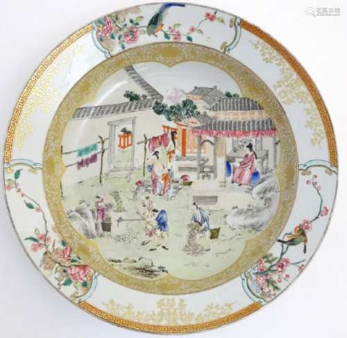 A large Chinese bowl with hand painted scenes of rural