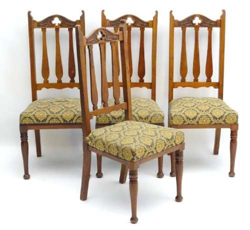 A set of four early 20thC Art Nouveau walnut dining