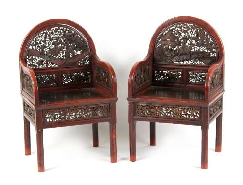 A pair of late 19th century Chinese carved red lacquer throne chairs (2).