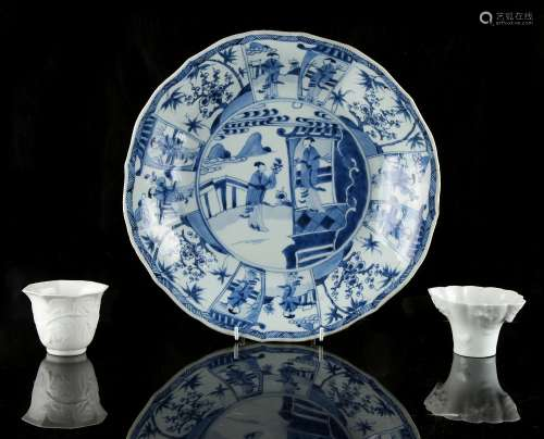 A Chinese blue & white shallow dish, Kangxi period (1662-1722), with alternating panels of ladies