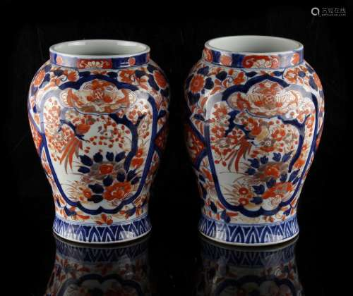 Property of a lady - a pair of late 19th century Japanese Imari vases, each 9.8ins. (25cms.) high (