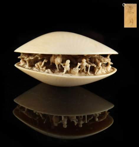 Property of a lady - a Japanese carved ivory okimono depicting the clam's dream, signed Ungetsu,