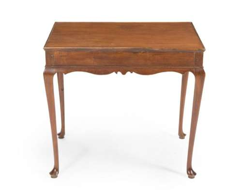 An English Queen Anne-style footed side table