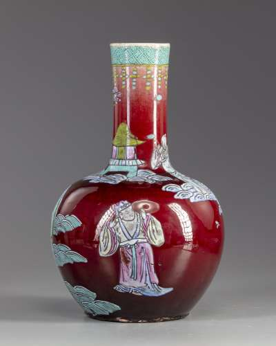 A Chinese famille rose red glazed bottle vase
