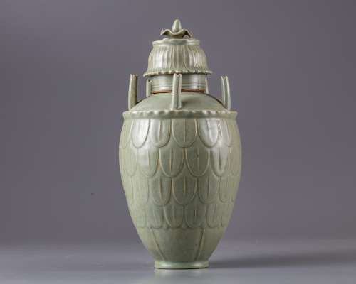 A Chinese celadon glazed vase and cover