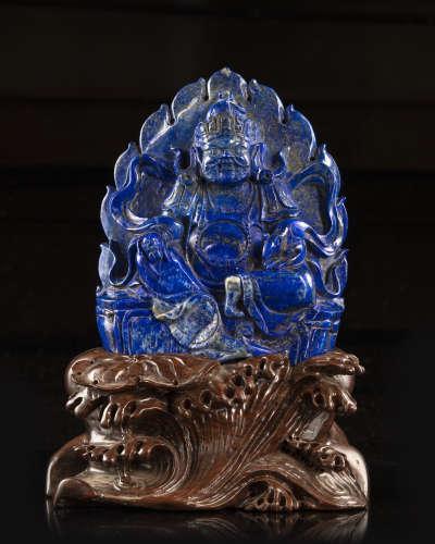 A Chinese lapis lazuli figure of Jambhala.
