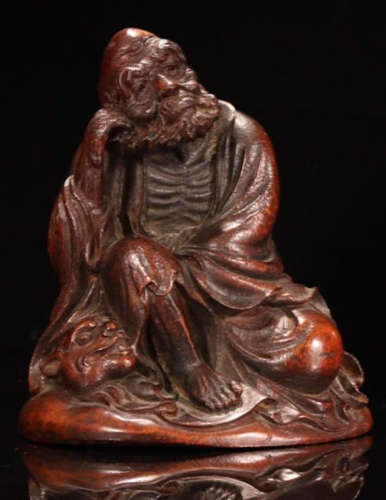 A BAMBOO CARVED LUOHAN BUDDHA
